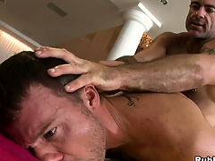 Sex-mad daddy bear fucking a young hunk in a hot hardcore anal gay video