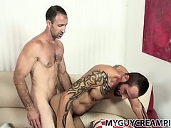 Tattooed hunk gets a bum full of cum from his hung sex-friend