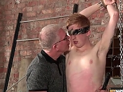 Master blows this cute boy in bondage