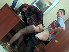 Feminine co-worker in a female suit getting his hose creamed at work