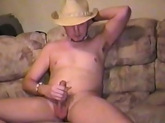 Sexy young smile radiantly plays with his balls and takes his cock to pleasure