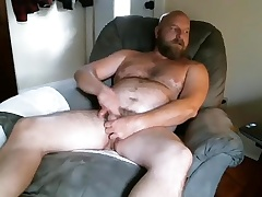 Dishy tramp is masturbating in the guest court and filming himself aloft webcam