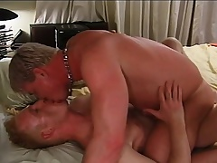 Attractive blonde well-pleased lovers engage in hardcore anal sex on the bed