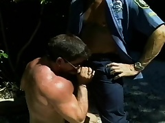 Hunky constable wants to get his dick sucked by a naughty superstud