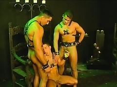 Three slaves in their leather harnesses are allowed to have a threesome