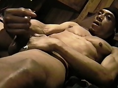Muscled black stud massages his big balderdash and strokes his huge prick
