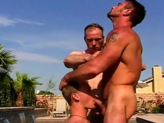 Gay lovemaking by the pool and in the pool house