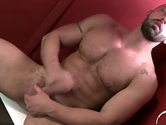 Bearded guy jerks off coupled with shoots his load