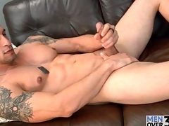 Muscular solo guy is unruffled and down in the mouth as he strokes