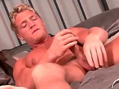 Muscular smooth blonde guy jerks off onto his stomach
