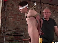 Daddy jerks elsewhere bound boy with regard to BDSM video