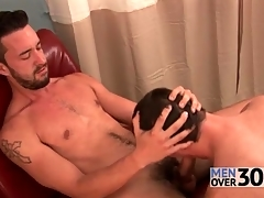 Outrageous pubes and beard on dude getting a blowjob