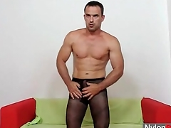 Muscular beggar in pantyhose fucks a toy