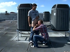 This young sexy boy enjoys his first gay blowjob at the roof.
