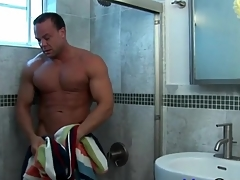 Insipid muscle man takes a shower and strokes