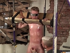 Sweaty varlet in bondage gets a hot handjob