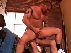 Muscular tattooed hottie sits chiefly a big cock