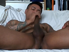 Gay latino tugs his cock and cums