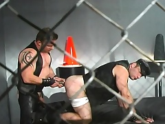 Leather affectionate gay studs swindle in hardcore sex action in the lock-up