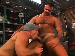Muscled gay mechanics engage almost a hardcore threesome almost make an issue of garage