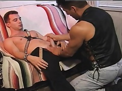 Two horny leather lovers take turns blowing each other's fixed cocks