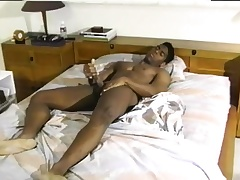 Sexy black man with a wonderful diet gives it to himself on the bed