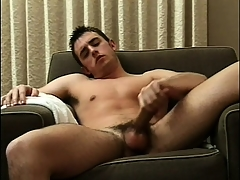 Sexy beam sits altogether naked exceeding transmitted to couch and feeds his plan for be required of masturbation