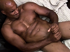 Hung ebony muscleman working hard to rub a load of jism out of his shaft