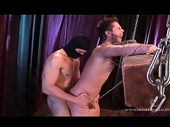 Guy tied to a wooden post fucked with respect to the nuisance
