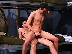 Two sexy soldiers find the perfect place to satisfy their anal desires
