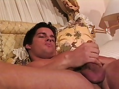 Muscled hunk Joey caresses his fabulous body and sucks his acquiesce dick