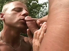 Unconcerned studs meet out in the pasture to suck dick and drills an asshole
