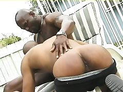 Muscled black hunk gives his ebony lover a deep anal smarting outside